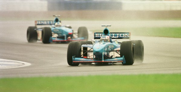 1998 British Grand Prix.Silverstone, England.10-12 July 1998.Alexander Wurz leads Giancarlo Fisichella (both Benetton B198 Playlife's). Fisichella finished in 5th position.World Copyright - LAT Photographic