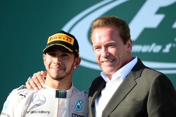 Race winner Lewis Hamilton (GBR) Mercedes AMG F1 and Arnold Schwartzenegger (AUT) on the podium at Formula One World Championship, Rd1, Australian Grand Prix, Race, Albert Park, Melbourne, Australia, Sunday 15 March 2015. BEST IMAGE