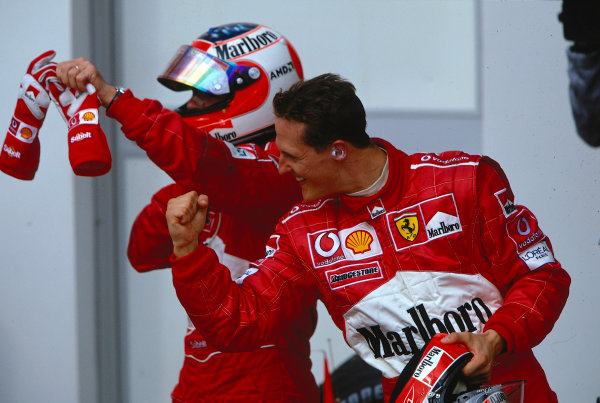 2002 San Marino Grand Prix.Imola, Italy.12-14 April 2002.Michael Schumacher and Rubens Barrichello (both Ferrari) celebrate 1st and 2nd positions respectively in parc ferme.Ref-02 SM 32.World Copyright - LAT Photographic