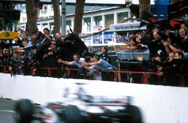 Mika Hakkinen (FIN) Mclaren  MP4-13 passes his team to win the race. Formula One World Championship, Rd 6, Monaco Grand Prix, Monaco, 24 May 1998