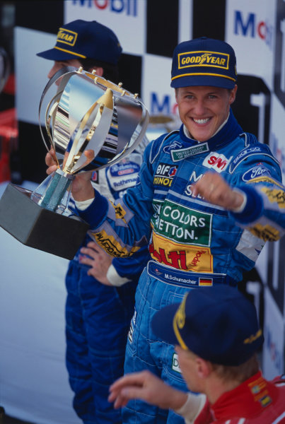 1994 Belgian Grand Prix.Spa-Francorchamps, Belgian.26-28 August 1994.Michael Schumacher (Benetton Ford) 1st position, but later disqualified because his skidblock or plank from the car's undertray was found to be below the required legal measurement. Behind Damon Hill (Williams Renault) now 1st position and infront Mika Hakkinen (McLaren Peugeot) now 2nd position on the podium. Ref-94 BEL 03.A Race Through Time exhibition number 26.World Copyright - LAT Photographic