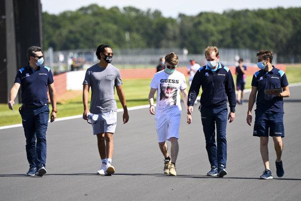 Sean Gelael (IDN, DAMS) and Dan Ticktum (GBR, DAMS) walk the track