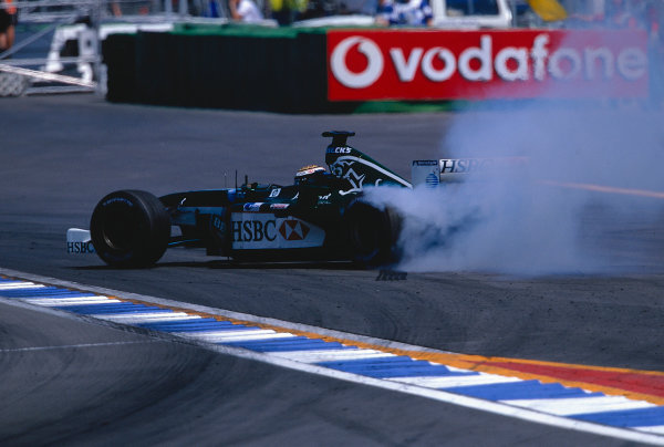 2002 German Grand Prix.Hockenheim, Germany. 26-28 July 2002.Eddie Irvine (Jaguar R3) smokes up his rears, as he recovers after a quick spin.Ref-02 GER 25.World Copyright - LAT Photographic
