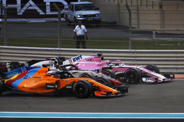 Sergio Perez, Racing Point Force India VJM11, Kevin Magnussen, Haas F1 Team VF-18, and Fernando Alonso, McLaren MCL33