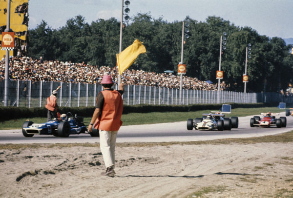 Jackie Stewart, March 701 Ford leads a group of cars through a yellow flag zone.