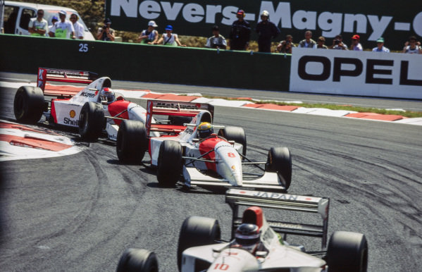 Ayrton Senna, McLaren MP4-8 Ford, leads Michael Andretti, McLaren MP4-8 Ford.