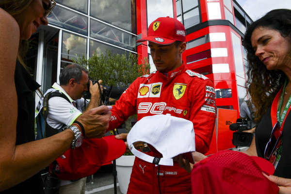 Charles Leclerc, Ferrari, signs autographs for fans