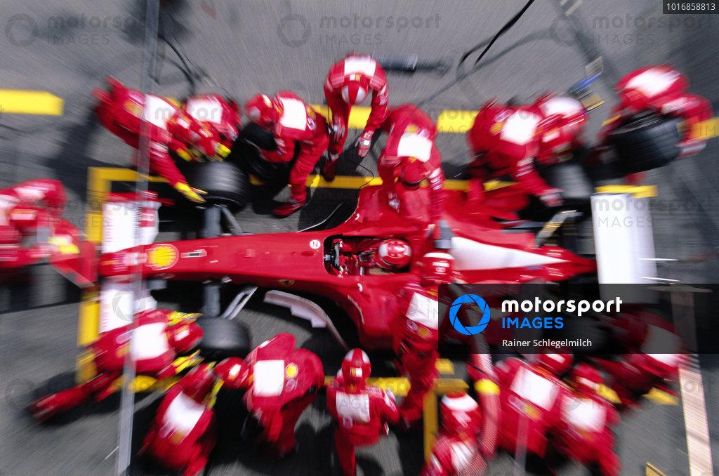 Michael Schumacher, Ferrari F2002, makes a pitstop.
