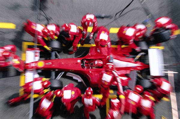 Michael Schumacher, Ferrari F2002, makes a pitstop.