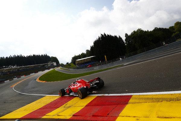 Kimi Raikkonen, Ferrari SF71H, strikes up sparks.