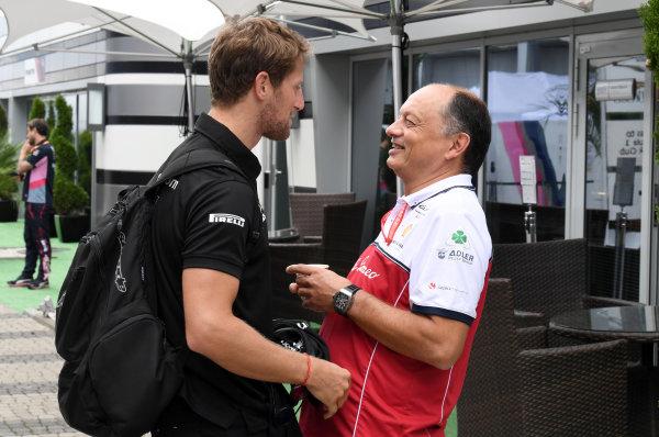 Romain Grosjean, Haas F1 speaks with Frederic Vasseur, Team Principal, Alfa Romeo Racing