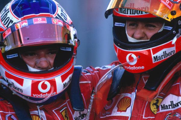 2004 Hungarian Grand Prix Hungaroring, Hungary. 13th - 15th August. Michael Schumacher, Ferrari F2004 and Rubens Barrichello, Ferrari F2004 celebrate their 1-2.World Copyright:PICME/LAT Photographic Ref:35mm Image:A17