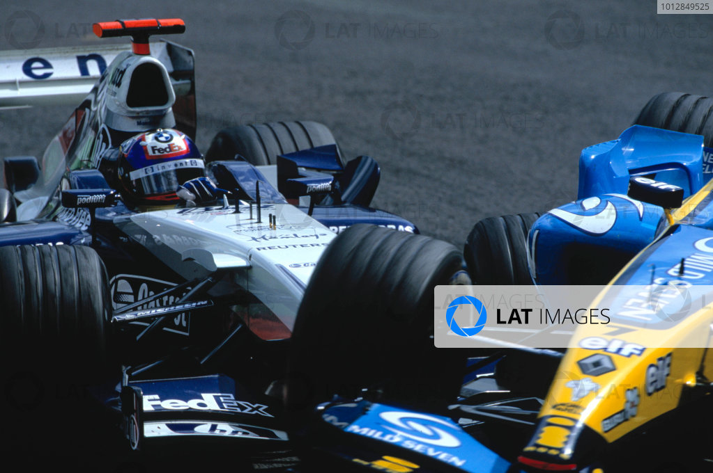 2004 Belgian Grand Prix.Spa Francorchamps, Belgium. 27th - 29th August.Juan Pablo Montoya, WilliamsF1 BMW FW26 makes contact with Jarno Trulli, Renault R24 in the bus stop. Action. World Copyright:LAT PhotographicRef:35mm Image A06