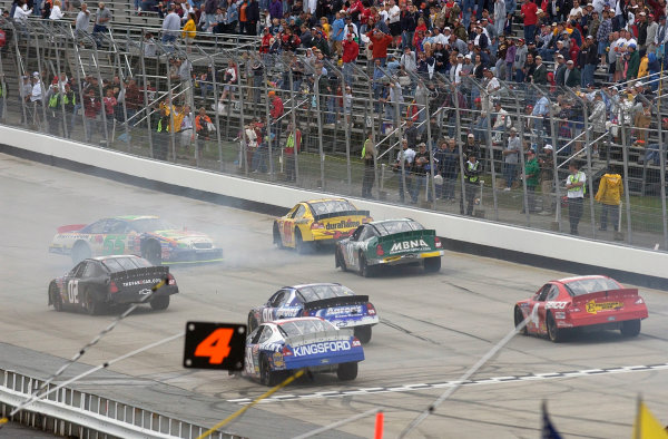 04-06 June, 2004, Dover International Speedway, USA,Robby Gordon spins as cars take evasive action,Copyright-Robt LeSieur 2004 USALAT Photographic