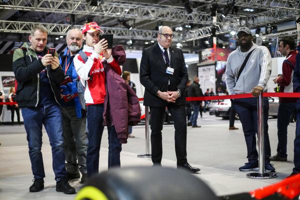 Autosport International Exhibition. National Exhibition Centre, Birmingham, UK. Saturday 13th January 2018. Visitors examine a Ferrari on display.World Copyright: Jakob Ebrey/LAT Images Ref: JR3_3777