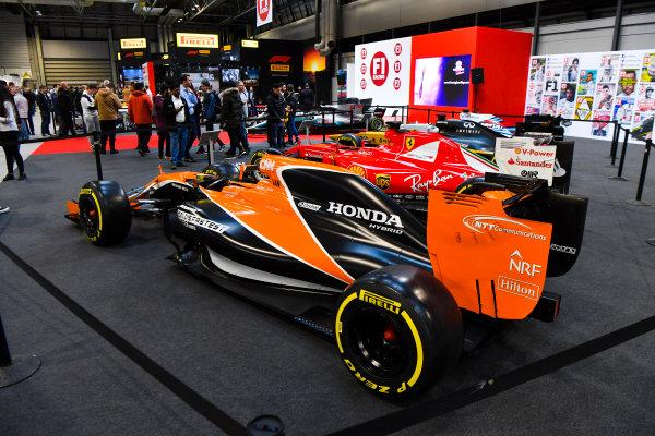 Autosport International Exhibition. National Exhibition Centre, Birmingham, UK. Thursday 11th January 2018. A McLaren and Ferrari on the F1 Racing Stand.World Copyright: Mark Sutton/Sutton Images/LAT Images Ref: DSC_7610