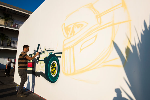 Autodromo Hermanos Rodriguez, Mexico City, Mexico. Friday 27 October 2017. An artist paints some F1 street art on to a wall. World Copyright: Sam Bloxham/LAT Images  ref: Digital Image _W6I9576