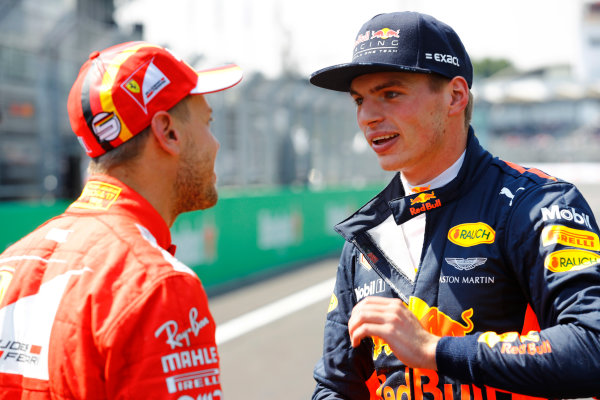 Autodromo Hermanos Rodriguez, Mexico City, Mexico. Saturday 28 October 2017. Pole winner Sebastian Vettel, Ferrari, talks to second-qualifer Max Verstappen, Red Bull Racing,  World Copyright: Steven Tee/LAT Images  ref: Digital Image _R3I5444