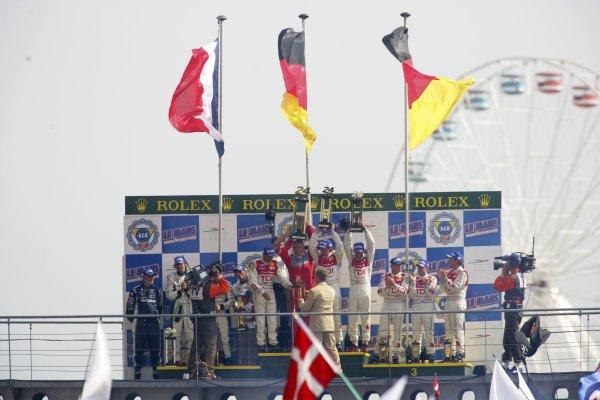 2006 Le Mans 24 Hours, Le Mans, France.14th - 18th June. LMP1 Podium. F Biela (DEU)/ E Pirro (ITA)/ M Werner (DEU), Audi Sport Team Joest. and E Helary (FRA)/ S Loeb (FRA)/ F Montagny (FRA), Pescarolo Sport, Pescarolo Judd. and R Capello (ITA)/ T Kristensen (DNK)/ A McNish (GBR), Audi Sport Team Joest. Celebrate their win on the podium.World Copyright: Andrew Ferraro/LAT PhotographicRef: Digital Image Only ZP9O1508