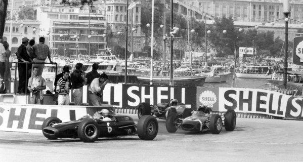 1966 Monaco Grand Prix.Monte Carlo, Monaco. 22 May 1966.Mike Spence, Lotus 33-BRM, retired, leads Jo Siffert, Brabham BT11-BRM, retired, and Jack Brabham, Brabham BT19-Repco, retired, action.World Copyright: LAT PhotographicRef: Motor b&w print