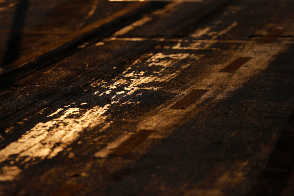 Hungaroring, Budapest, Hungary. Friday 24 July 2015. Track surface detail as the sun rises. World Copyright: Charles Coates/LAT Photographic ref: Digital Image _N7T6227