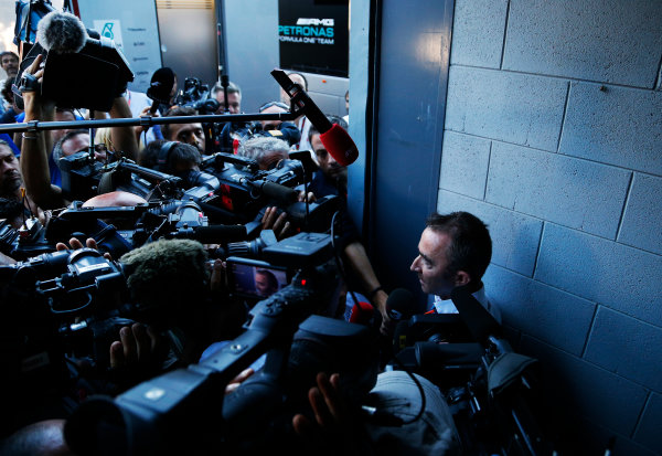 Autodromo Nazionale di Monza, Monza, Italy. Sunday 6 September 2015. Paddy Lowe, Executive Director (Technical), Mercedes AMG, is swamped by the press as he leaves an FIA stewards enquiry concerning Mercedes' tyre pressures. World Copyright: Jed Leicester/LAT Photographic ref: Digital Image _L2_9547