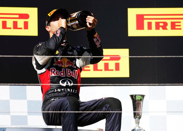 Hungaroring, Budapest, Hungary. Sunday 26 July 2015. Daniel Ricciardo, Red Bull Racing, 3rd Position, downs some Champagne on the podium. World Copyright: Glenn Dunbar/LAT Photographic ref: Digital Image _W2Q1189