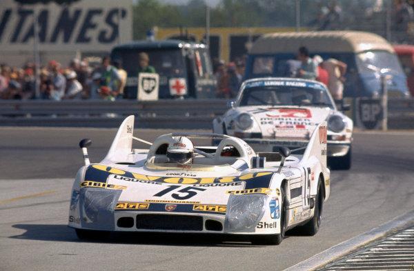 Le Mans, France. 14 - 15 June 1975 Reinhold Joest/Jurgen Barth/Mario Casoni (Porsche 908/3LH), 4th position, leads Joel Laplacette/Alain Leroux/Claude Pigeon (Porsche Carrera RS), 25th position, action. World Copyright: LAT PhotographicRef: 75LM07