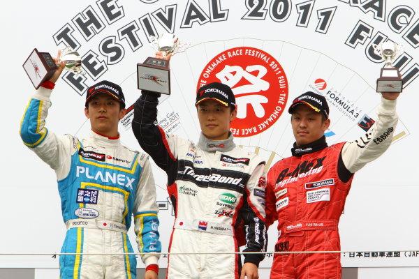 Fuji, Japan. 12th June 2011Rd 4 Winner Hironobu Yasuda ( #12 ThreeBond Racing ) 2nd positiion Hideki Yamauchi ( #5 HANASHIMA RACING ) 3rd position Yuhi Sekiguchi ( #50 B-MAX ENGINEERING ), podium.World Copyright: Yasushi Ishihara/LAT Photographicref: Digital Image 2011JF3_R4_004