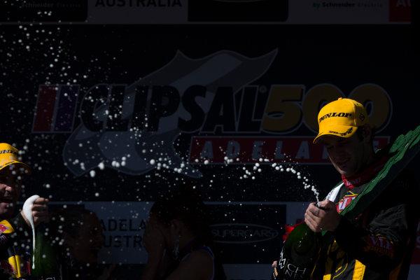 2013 V8 Supercar Championship. Round 1. Clipsal 500, Adelaide. 3rd March 2013. Sunday Race 2. Shane van Gisbergen (VIP Petfoods/Tekno Autosports – Holden Commodore VF) celebrates on the podium. Portrait.  World Copyright:  Daniel Kalisz/LAT Photographic Ref: Digital Image DKAL7491.jpg .