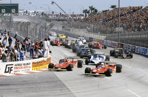 Jody Scheckter, Ferrari 312T4 makes a move on pole sitter Gilles Villeneuve, Ferrari 312T4 at the start ahead of Patrick Depailler, Ligier JS11 Ford and Mario Andretti, Lotus 79 Ford.