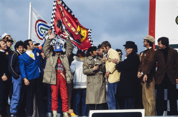 Gilles Villeneuve celebrates victory at the new Montreal circuit. Jody Scheckter, 2nd position, stands to the left while Jackie Stewart performs interviews on the right, with co-presenter Sam Posey.