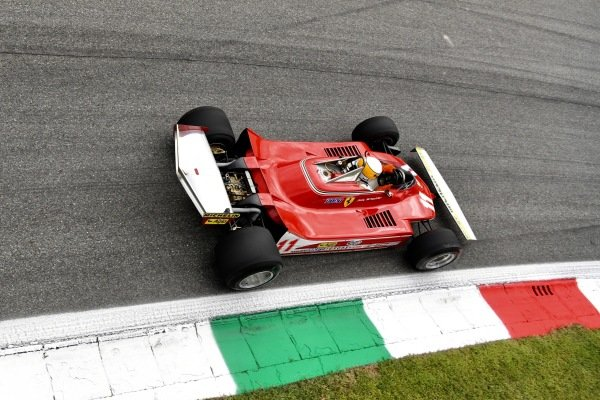 Jody Scheckter demonstrates the Ferrari 312T4 he drove to title success in 1979