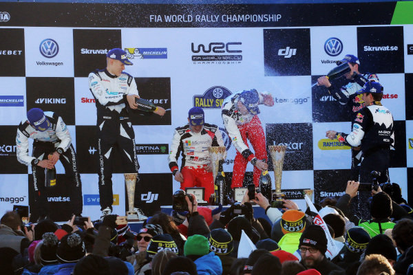 (L to R): Second placed Ott Tanak (EST) / Martin Jarveoja (EST), M-Sport World Rally Team WRC, rally winners Jari-Matti Latvala (FIN) / Miikka Anttila (FIN), Toyota Gazoo Racing WRC and third placed Sebastien Ogier (FRA) / Julien Ingrassia (FRA), M-Sport World Rally Team WRC celebrate on the podium with the champagne at World Rally Championship, Rd2, Rally Sweden, Day Three, Karlstad, Sweden, 12 February 2017.