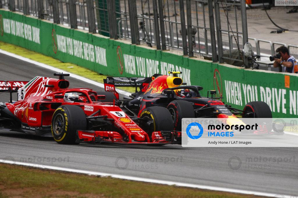 Max Verstappen, Red Bull Racing RB14 Tag Heuer, overtakes Sebastian Vettel, Ferrari SF71H.