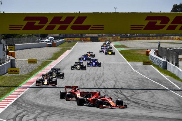 Sebastian Vettel, Ferrari SF90, leads Charles Leclerc, Ferrari SF90, Pierre Gasly, Red Bull Racing RB15, Romain Grosjean, Haas VF-19, Kevin Magnussen, Haas VF-19, and Daniil Kvyat, Toro Rosso STR14