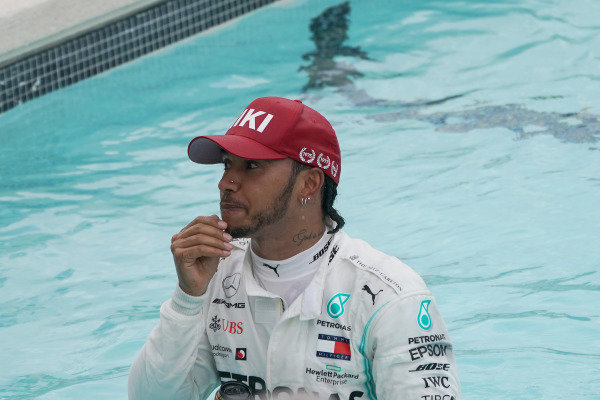 Lewis Hamilton, Mercedes AMG F1, takes a dip in the Swimming Pool