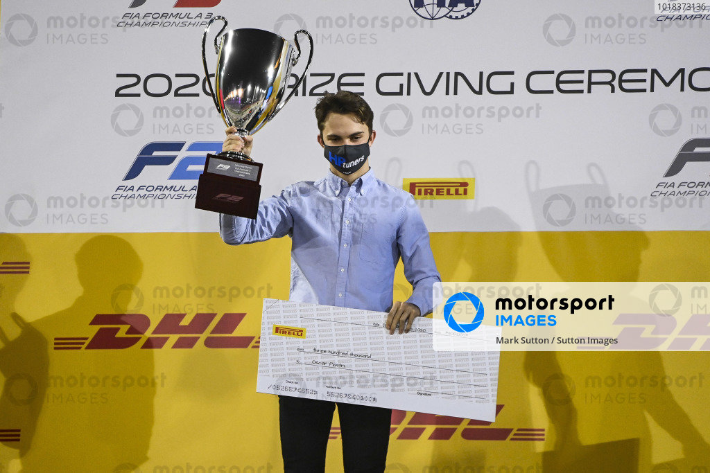 F3 Championship Winner Oscar Piastri (AUS, PREMA RACING) celebrates on the podium with the trophy