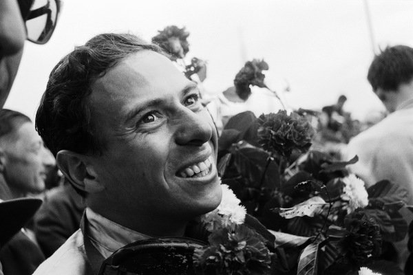 Jim Clark celebrates after winning the race.