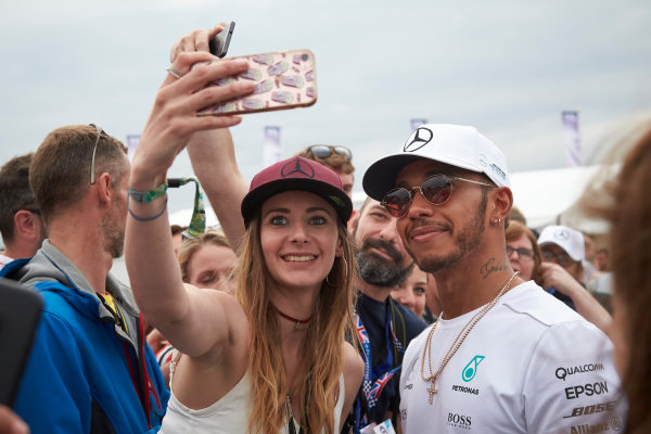 Silverstone, Northamptonshire, UK.  Sunday 16 July 2017. Lewis Hamilton, Mercedes AMG, takes a picture with a fan after the race. World Copyright: Steve Etherington/LAT Images  ref: Digital Image SNE19915