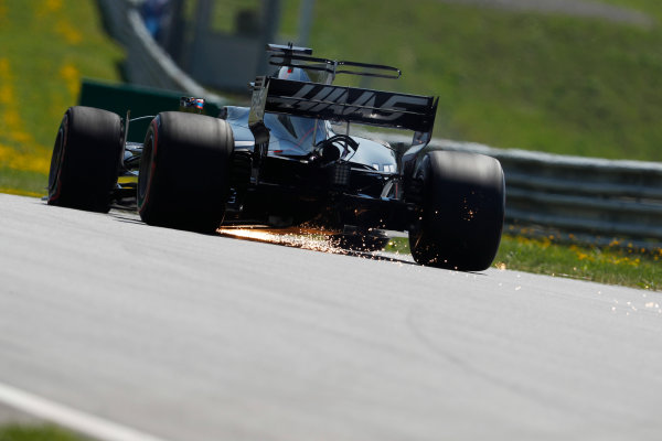 Red Bull Ring, Spielberg, Austria. Friday 07 July 2017. Romain Grosjean, Haas VF-17, strikes sparks as he drives back to the pits in FP1 with a front left puncture. World Copyright: Glenn Dunbar/LAT Images ref: Digital Image _X4I4556