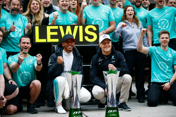 Shanghai International Circuit, Shanghai, China.  Sunday 09 April 2017.  Lewis Hamilton, Mercedes AMG, celebrates victory with Valtteri Bottas, Mercedes AMG and colleagues. World Copyright: Andrew Hone/LAT Images  ref: Digital Image _ONY6083