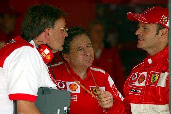 (L to R): Kees van de Grint (NED) Senior Bridgestone Engineer, Jean Todt (FRA) Ferrari General Manager and Rubens Barrichello (BRA) Ferrari.