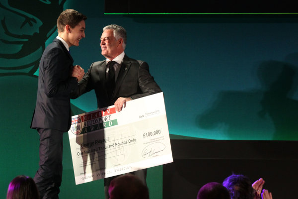 2014 BRDC Annual Awards The Grand Connaught Rooms, London, UK Monday 8 December 2014. George Russel accepts his prize money from Derek Warwick after winning the McLaren Autosport BRDC Young Driver Award. World Copyright: Ebrey/LAT Photographic. ref: Digital Image Russell-02 (2)
