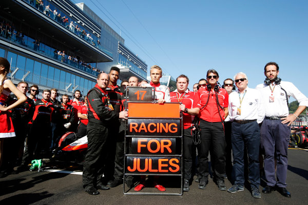 Sochi Autodrom, Sochi, Russia. Sunday 12 October 2014. Max Chilton, Marussia F1, and the Marussia team tribute to Jules Bianchi, Marussia F1. World Copyright: Charles Coates/LAT Photographic. ref: Digital Image _N7T5920