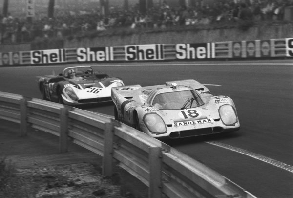Le Mans, France. 13th - 14th June 1970. Gijs van Lennep / David Piper, Porsche 917K, retired, leads Andrea de Adamich / Piers Courage, Alfa Romeo T33/3, retired, action.  World Copyright: LAT Photographic. Ref:  1297C - 22-22A.