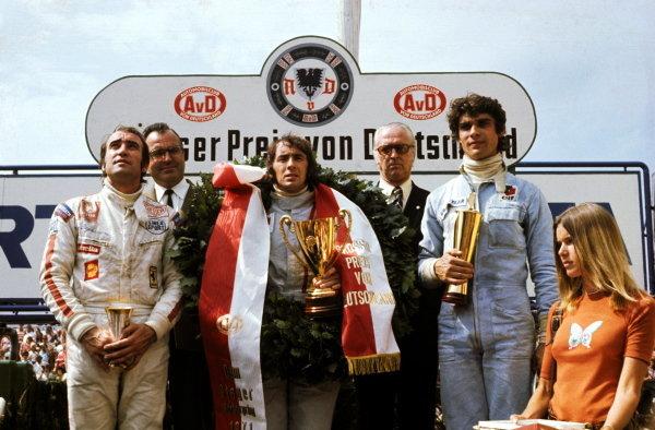The podium (L to R): Clay Regazzoni (SUI) Ferrari third; Jackie Stewart (GBR) Tyrrell race winner; Francois Cevert (FRA) Tyrrell second; Helen Tyrrell (GBR), wife of Jackie. German Grand Prix, Nurburgring, 1 August 1971. BEST IMAGE