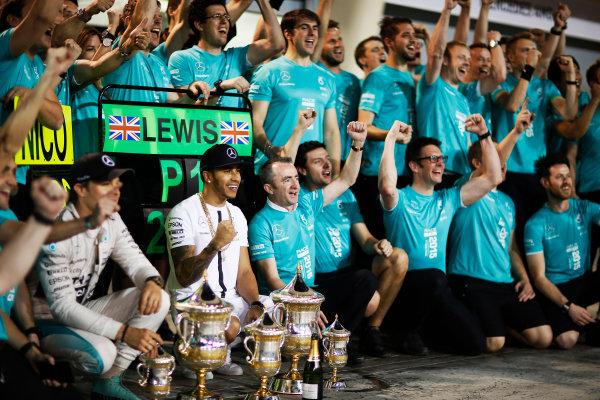Bahrain International Circuit, Sakhir, Bahrain. Sunday 19 April 2015. Lewis Hamilton, Mercedes AMG, 1st Position, Nico Rosberg, Mercedes AMG, 3rd Position, and the Mercedes team celebrate victory. World Copyright: Alastair Staley/LAT Photographic. ref: Digital Image _R6T1265