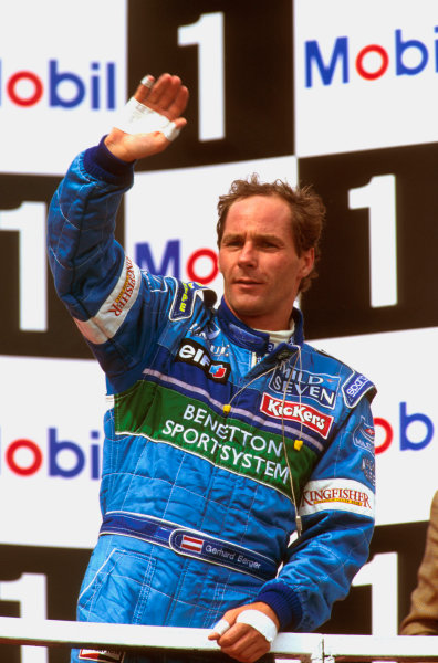 Imola, Italy.3-5 May 1996.Gerhard Berger (Benetton Renault) 3rd position celebrates on the podium.Ref-96 SM 03.World Copyright - LAT Photographic
