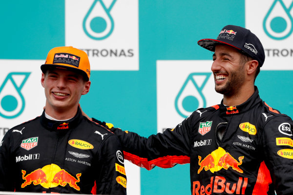 Sepang International Circuit, Sepang, Malaysia. Sunday 1 October 2017. Max Verstappen, Red Bull, 1st Position, and Daniel Ricciardo, Red Bull Racing, 3rd Position, on the podium. World Copyright: Glenn Dunbar/LAT Images  ref: Digital Image _X4I4012